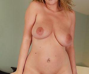Curvy blonde mom Lexi Lexxx fondling huge saggy boobs in a thong