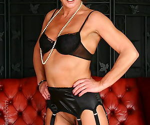 Fully clothed mature redhead Lady Sarah flashing pierced twat
