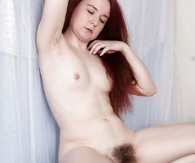 Redheaded solo girl Annabelle Lee baring tiny tits and really hairy pussy