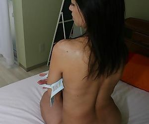 Slender asian chick Terumi Irie showcasing her soaking twat on the bed