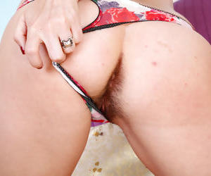 Hot older brunette Dixie Comet plays with her hairy muff after stripping