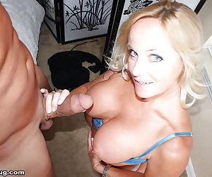 Buxom blonde mom lets her big knockers loose and jacks dick for cumshot