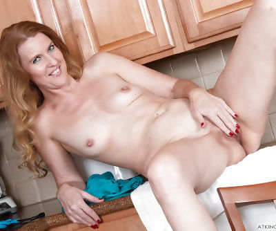 Older housewife Lacy flashing upskirt panties and tiny tits in kitchen