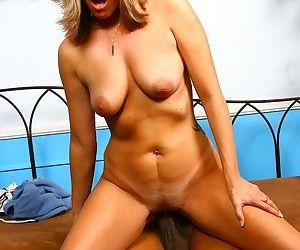 Blonde cougar Joey Lynn fucks a black man while her son watches