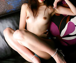 Stuning asian babe with tiny tits and sexy legs posing in lacy panties