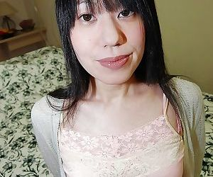 Shy asian chick with hairy pubis strips down and has some pussy vibing fun