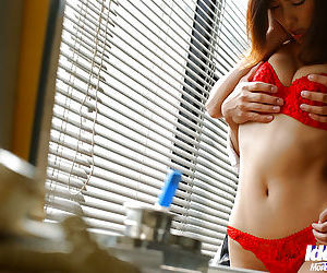 Bosomy asian babe in red lingerie gives a blowjob and gets fucked hardcore