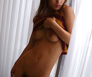 Hot asian babe with petite tits Ryoko Mitake taking off her clothes