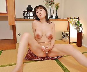 Long-haired asian MILF Kuniko Hara stripping and toying her hungry twat
