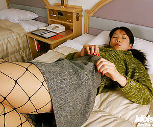 Sexy asian babe in pantyhose Kurumi Morishita stripping off her clothes