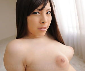 Japanese beauty Erena Tokiwa bares big perky tits for closeup of puffy nipples
