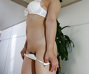 Asian gal Tomoe Asai strips down and has some pussy toying and fingering fun
