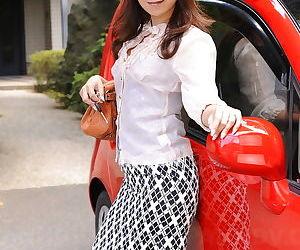 Sexy Asian Erika Hiramatsu squats in short skirt and high heels outdoors