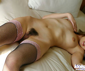 Stunning asian babe slipping off her clothes and stockings