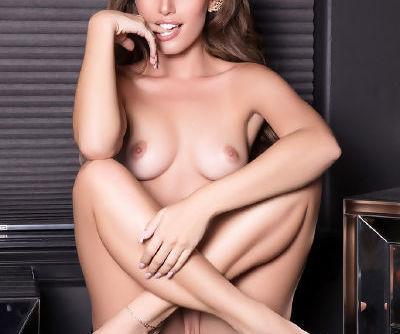 Solo model Melissa Lori removes her satin lingerie for a centerfold shoot