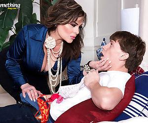 Mature mom Ciara Ryder lets her huge big tits hang down for tongue and titjob
