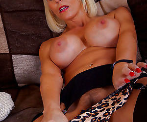 Playful mature knockout in stockings slipping off her snazzy lingerie