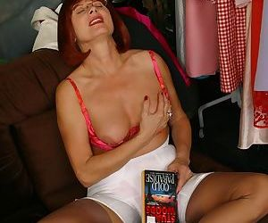 Older mature redhead Miss Abigail fondles her breasts as she reads smut