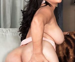 Mature Mexican lady Victoria Versaci uncorks her hooters as she strips naked