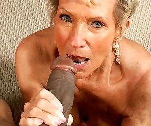 Granny Sandra Ann sucks on a black pecker before she is fucked hard