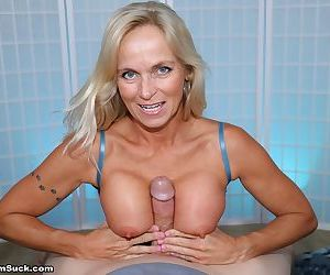 Older blonde woman Dani Dare bares her big boobs before a POV handjob and BJ