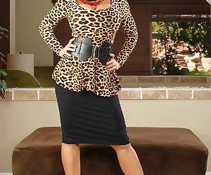 Brunette female Lisa Ann doffs a black skirt on way to nude poses