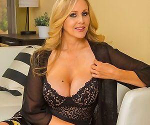 American female Julia Ann reveals big boobs and various tattoos