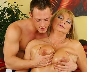 Lusty mature lady gets fucked and milks a boner with her oiled up jugs