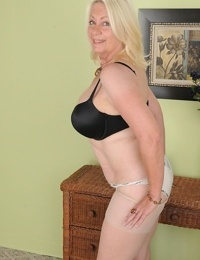 Fatty mature blondie Angelique is revealing her big boobies