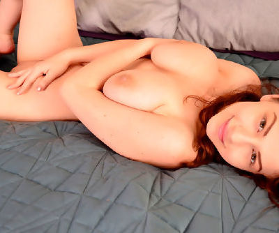 Amazing and curly haired solo babe with red hair is showing her small natural boobies