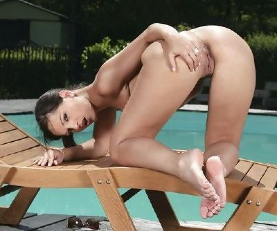 Lusty girl Eve Angel strips from her bikini and shows off her hot pussy