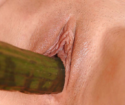 Awesome and short haired angel with nice tits loves to fuck her twat with cucumber in the kitchen