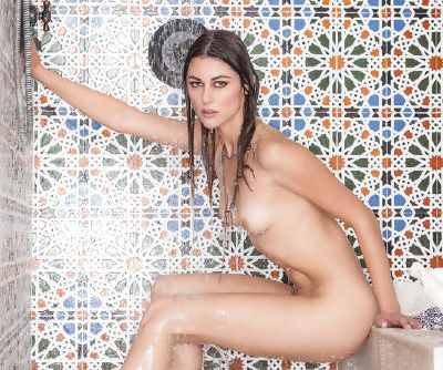 Hannah Mae posing naughty under the warm shower by undulating her nude forms