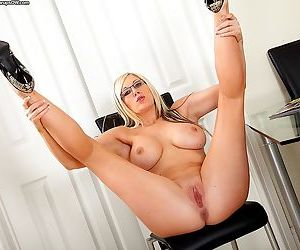 Busty mature bombshell in glasses undressing and spreading her long legs