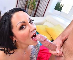Tattooed female with pierced nipples and pussy gives her stepson a blowjob