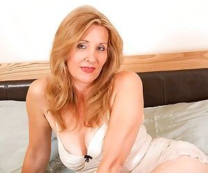 Mature lady Camilla plays with big enough dildo dreaming about a hot guy