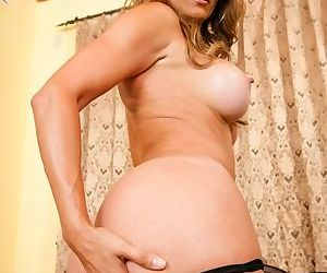 Sexy Latina MILF Monique Fuentes revealing her monster curves on the sofa
