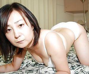 Lusty Japanese MILF strips down and has some pussy vibing fun - part 2