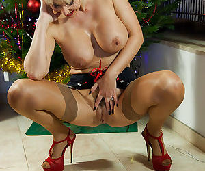 Christmas time with mature nylon model Jan Burton is full of sexy pics - part 2