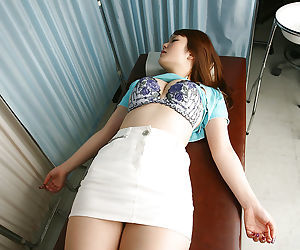 Busty asian babe Rika Kijma gets stripped and gets her pussy examed