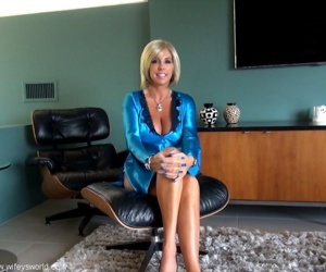 Kicky mature blonde in sexy outfit flashing her boobs and panties - part 2