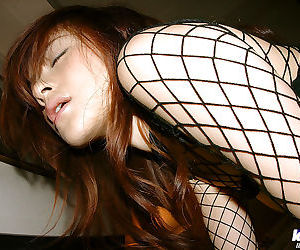 Horny asian babe Sumire Aida posing in BDSM outfit and masturbating her cunt