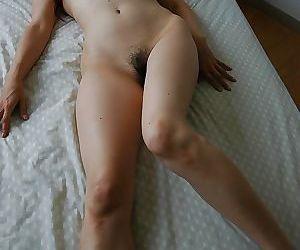 Asian MILF Chieko Kitani stripping down and exposing her juicy twat
