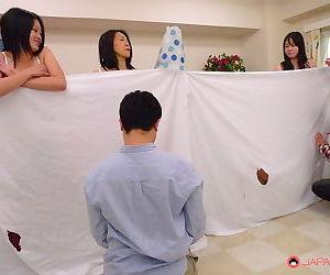 Asian women spread pussy for men in kinky peek-a-boo orgy & get cum on tits