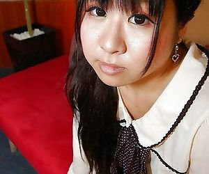 Shy asian schoolgirl getting nude and exposing her juicy slit in close up