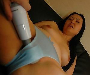 Asian lady plays with her sex toys and licks a swollen cock
