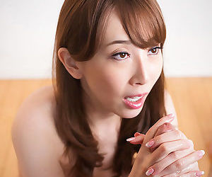 Japanese female plays with sperm after giving a handjob in the nude