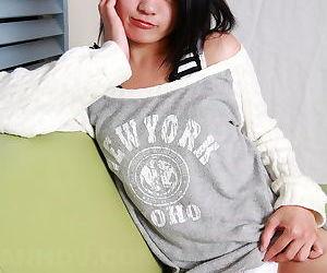Erotic Asian girl doffs her sweater to masturbate pussy in white panties