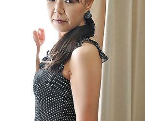 Asian MILF Rie Katano taking off her panties and playing with her sex toys