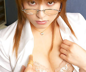 Redhead asian babe in glasses Karen Kisaragi slipping off her clothes